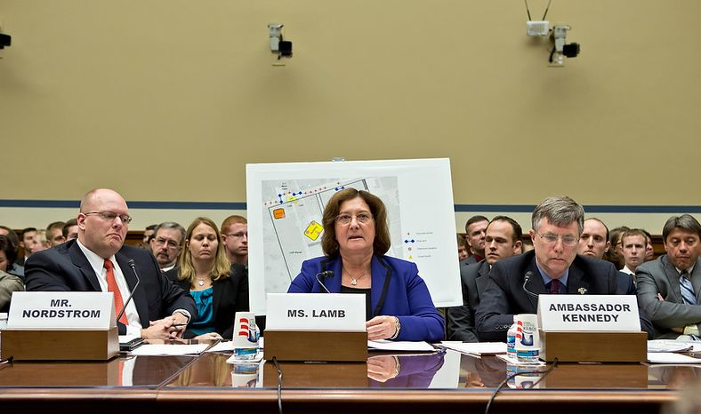 **FILE** Charlene Lamb (center), deputy assistant secretary for international programs at the State Department's Bureau of Diplomat Security, testifies Oct. 10, 2012, on Capitol Hill before the House Oversight and Government Reform Committee hearing investigating the Sept. 11, 2012 attack on the American consulate in Benghazi, Libya, that resulted in the death of U.S. Ambassador Christopher Stevens and other Americans. She is joined by Eric Nordstrom (left), a regional security officer with the State Department, and Amb. Patrick Kennedy, under secretary for management at the State Department. (Associated Press)