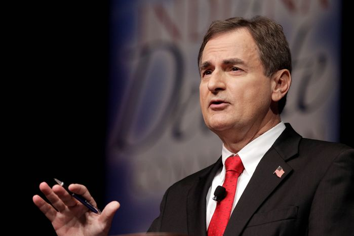"""Republican Richard Mourdock, candidate for Indiana's U.S. Senate seat, participates Oct. 23, 2012, in a debate in New Albany, Ind., with Democrat Joe Donnelly and Libertarian Andrew Horning. Mourdock, when asked during the final minutes of the debate whether abortion should be allowed in cases of rape or incest, said """"it's something God intended"""" when a woman is impregnated during a rape. (Associated Press)"""