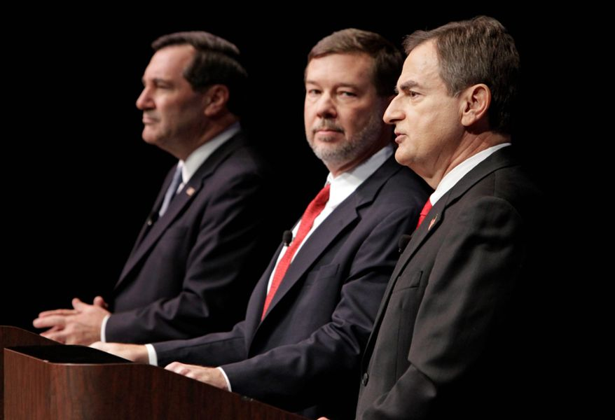 Indiana U.S. Senate candidates Joe Donnelly (left), a Democrat, libertarian Andrew Horning (center) and Republican Richard Mourdock participate in a debate in New Albany, Ind., on Oct. 23, 2012. (Associated Press)