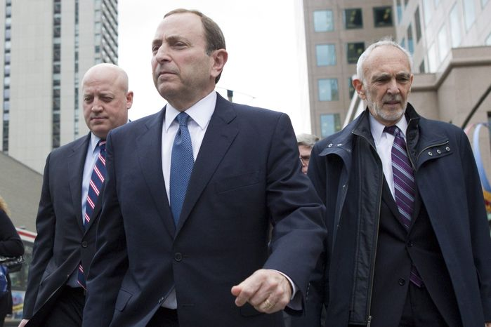 NHL Commissioner Gary Bettman, left,  leaves the NHLPA offices with Assistant Commissioner Bill Daly (left) and NHL lawyer Bob Betterman following collective bargaining in Toronto on Thursday, Oct. 18, 2012. (AP Photo/The Canadian Press, Chris Young)