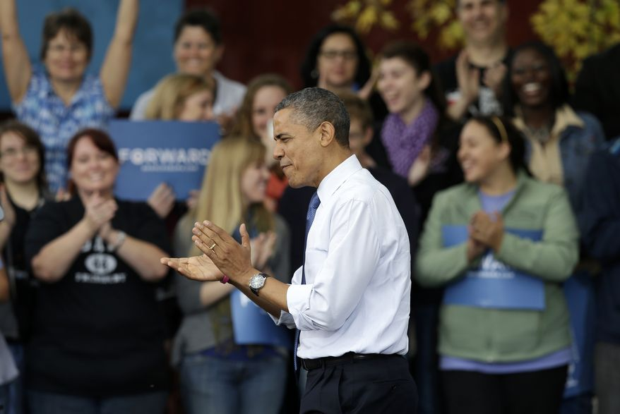 President Obama reacts as he is introduced at a campaign stop at the Mississippi Valley Fairgrounds in Davenport, Iowa, on Wednesday, Oct. 24, 2012. Mr. Obama is on a two-day campaign blitz across six battleground states. (AP Photo/Charlie Neibergall)