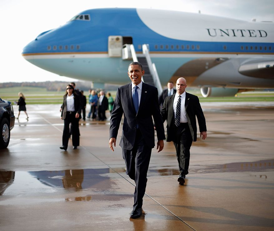 President Obama walks Oct. 24, 2012, across the tarmac to greet supporters upon his arrival on Air Force One at the Quad Cities International Airport in Moline, Ill. The president began a two-day campaign blitz through eight states with stops in key battleground states Iowa, Colorado, Nevada, Ohio and Virginia. (Associated Press)