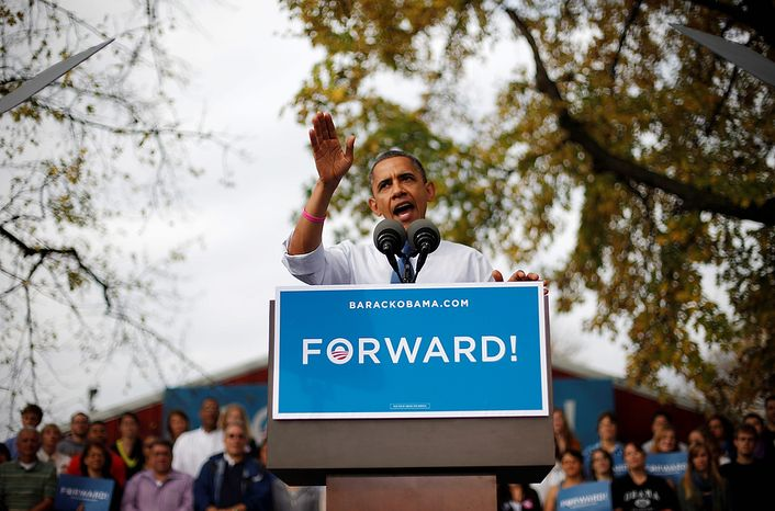 ** FILE ** President Obama speaks to supporters during an Oct. 24, 2012, campaign event at the Mississippi Valley Fairgrounds in Davenport, Iowa. The president began a two-day campaign blitz through eight states with stops in key battleground states Iowa, Colorado, Nevada, Ohio and Virginia. (Associated Press)