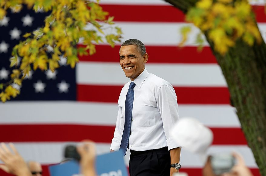** FILE ** President Obama smiles as he arrives at a campaign stop on Oct. 24, 2012, at The Mississippi Valley Fairgrounds in Davenport, Iowa. The president began a two-day campaign blitz through eight states with stops in key battleground states Iowa, Colorado, Nevada, Ohio and Virginia. (Associated Press)