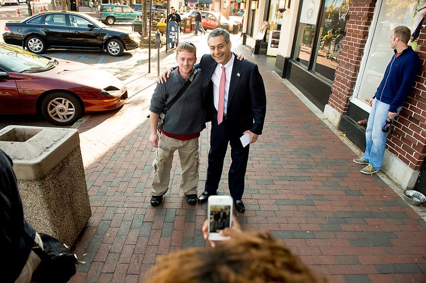 Rob Sobhani (center), an independent candidate for U.S. Senate from Maryland, poses for a cellphone photo with Brian Phipps (left) of Arnold, Md., as Mr. Sobhani greets voters along the downtown harbor in Annapolis on Wednesday, Oct. 17, 2012. (Andrew Harnik/The Washington Times)