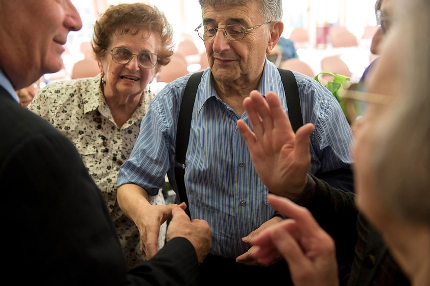 In the weeks leading up to Election Day, Larry Rosen (right) of Rockville, Md., asks a question of Sen. Benjamin L. Cardin, Maryland Democrat, at the Ring House retirement community in Rockville on Monday, Oct. 22, 2012. (Rod Lamkey Jr./The Washington Times)