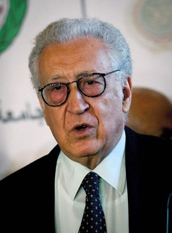 Lakhdar Brahimi, the U.N.-Arab League envoy to Syria, talks during a joint press conference with Arab League Secretary-General Nabil Elaraby (unseen) following their meeting at the league headquarters in Cairo on Wednesday, Oct. 24, 2012. Mr. Brahimi says the Syrian government and some rebel leaders have agreed to a cease-fire during the upcoming four-day Muslim holiday. (AP Photo/Nasser Nasser)