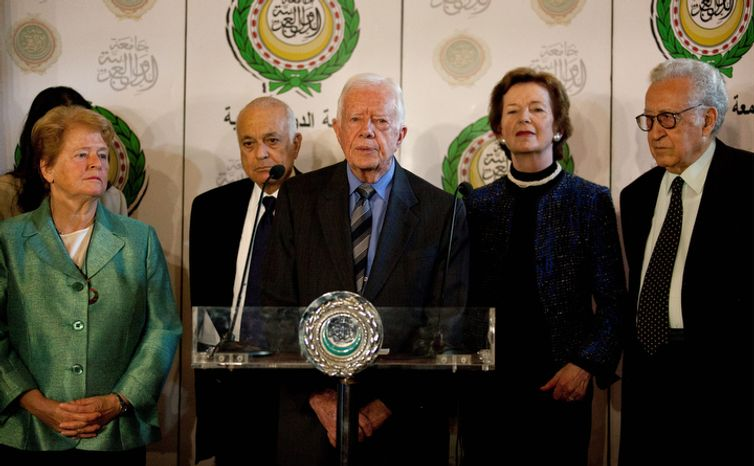 Lakhdar Brahimi (from right), the U.N.-Arab League envoy to Syria; former Irish President Mary Robinson; former U.S. President Jimmy Carter; Arab League Secretary-General Nabil Elaraby; and former Norwegian Prime Minister Gro Harlem Brundtland attend a press conference after their meeting at the Arab League headquarters in Cairo on Wednesday, Oct. 24, 2012. Mr. Brahimi says the Syrian government and some rebel leaders have agreed to a cease-fire during the upcoming four-day Muslim holiday. (AP Photo/Nasser Nasser)