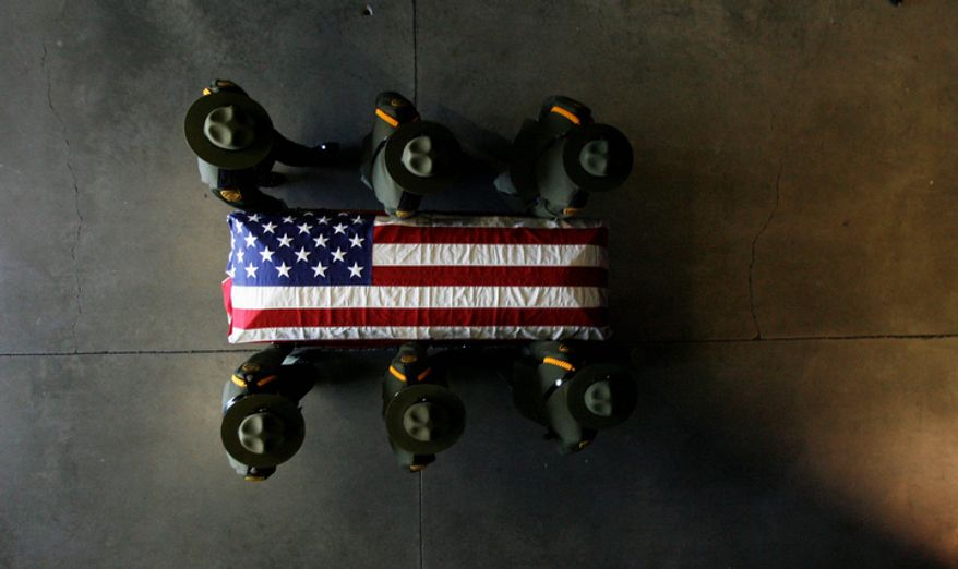 Border patrol agents carry the casket of agent Nicholas Ivie during his funeral at the UCCU Center at Utah Valley University in Orem, Utah, on Oct. 11, 2012. Ivie, a Provo, Utah, native, was killed Oct. 2 in a shooting at the Arizona-Mexico border. (Associated Press/The Salt Lake Tribune)