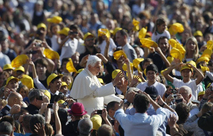 Pope Benedict XVI blesses the faithful as he arrives in St. Peter's Square at the Vatican on Wednesday, Oct. 24, 2012, for his weekly general audience. (AP Photo/Andrew Medichini)