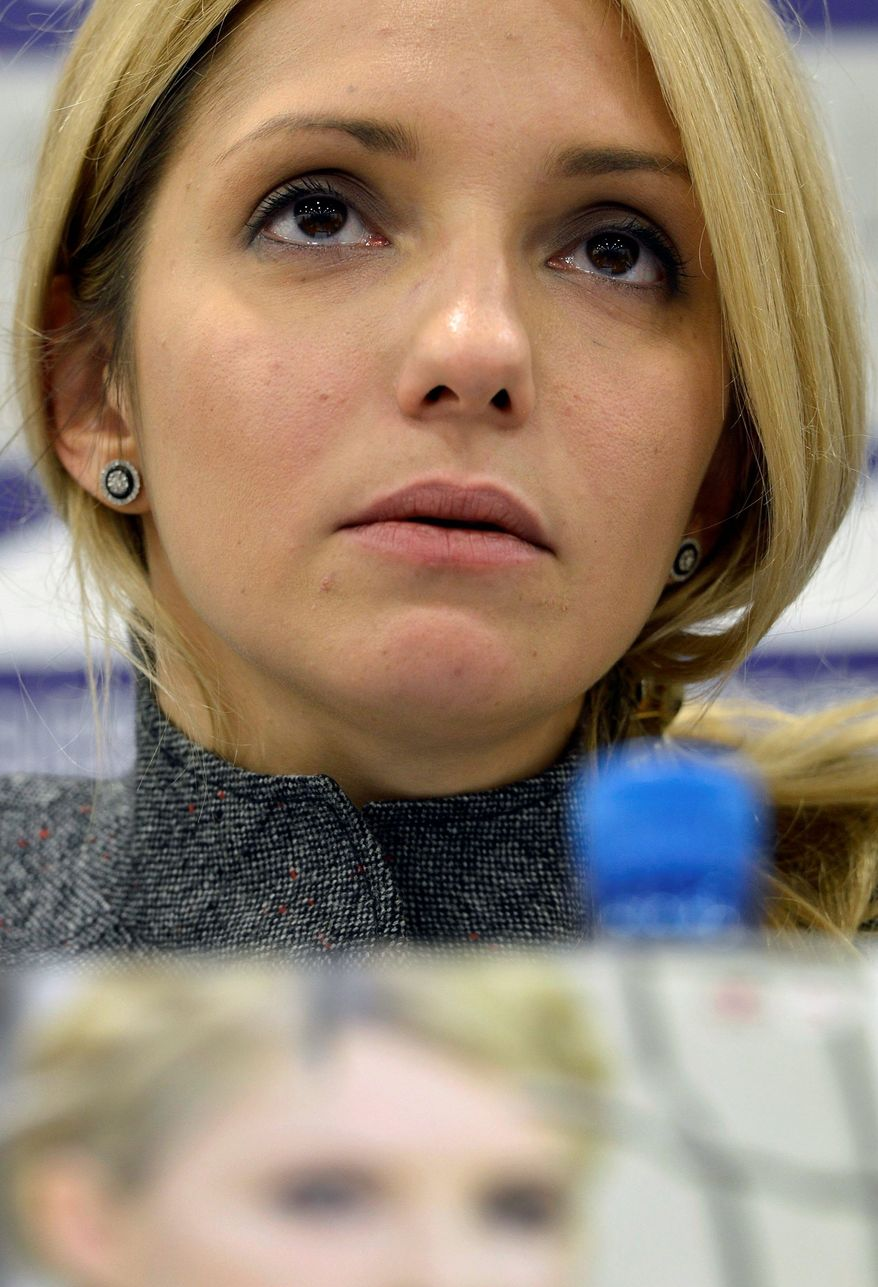 Yevgenia Tymoshenko, daughter of jailed former Ukrainian prime minister Yulia Tymoshenko, speaks during a press conference at the Geneva Press Club in Geneva, Switzerland, Wednesday, Oct. 24, 2012. Ukrainians vote Sunday in parliamentary elections overshadowed by the absence of jailed opposition leader Yulia Tymoshenko and marked by EU worries over the fate of democracy in the ex-Soviet state. (AP Photo/Keystone, Martial Trezzini)