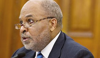 ** FILE ** In this Oct. 25, 2012, file photo, William P. White, D.C. Department of Insurance, Securities and Banking chief, testifies at an oversight hearing on Chartered Health Plan. (Barbara L. Salisbury/The Washington Times)