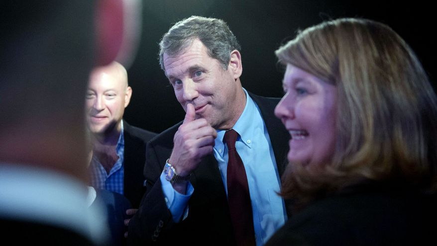 Democratic incumbent Sen. Sherrod Brown of Ohio talks with supporters after a U.S. Senate debate with his opponent, Ohio Treasurer Josh Mandel, at WCET-TV Studios in Cincinnati on Thursday. (Andrew Harnik/The Washington Times)