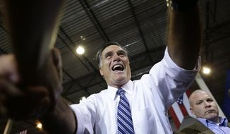 Republican presidential candidate, former Massachusetts Gov. Mitt Romney shakes hands with supporters as he campaigns at Jet Machine, which supplies components for the defense, aerospace, and oil and gas industry, Thursday, Oct. 25, 2012, in Cincinnati, Ohio. At right is a U.S. Secret Service agent. (AP Photo/Charles Dharapak)