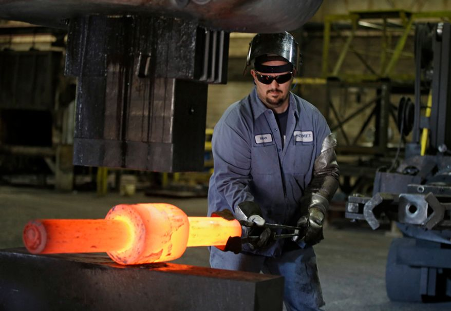 In this Thursday, Sept. 6, 2012, photo, Jack Knox positions a hot spindle being shape at Solmet Technologies in Canton, Ohio. U.S. manufacturing grew for the first time in four months, buoyed by a jump in new orders in September. The increase was a hopeful sign that the economy is improving. The Institute for Supply Management, a trade group of purchasing managers, said on Monday, Oct. 1, 2012, that its index of factory activity rose to 51.5, up from 49.6 in August. (AP Photo/Mark Duncan)