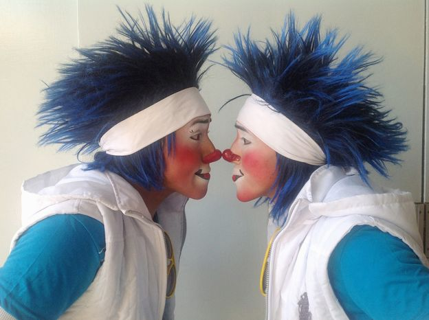 Los Chanclitias of Guatemala; Caitio, 21, and his brother Lunarsito, 20, pose for photos during Mexico's 17th annual clown convention, La Feria de la Risa, in Mexico City, Wednesday, Oct. 24, 2012. The Auguste clown duo have been performing for 11 years. (AP Photo/Anita Baca)