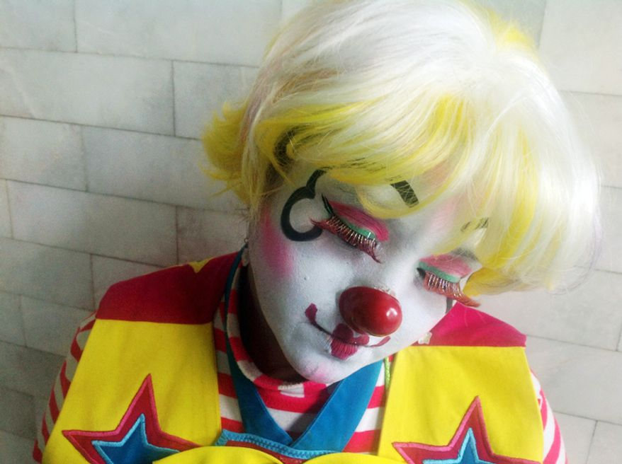 Jessycorazon, 36, poses for a photo during Mexico's 17th annual clown convention, La Feria de la Risa, in Mexico City, Wednesday, Oct. 24, 2012. Approximately 500 clowns gathered at two local theaters in the capital city to exchange ideas, compete for laughs and show off their comedy performances. Jessycorazon has been as a clown for 19 years. (AP Photo/Anita Baca)
