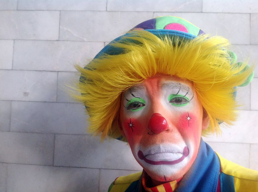 Patch, 36, an Auguste clown, poses for a photo during Mexico's 17th annual clown convention, La Feria de la Risa, in Mexico City, Wednesday, Oct. 24, 2012. Approximately 500 clowns gathered at two local theaters in the capital city to exchange ideas, compete for laughs and show off their comedy performances. Patch has been as a clown for 13 years. (AP Photo/Anita Baca)