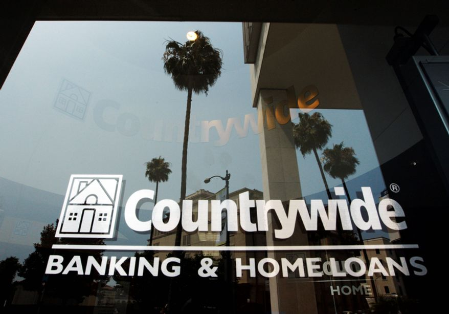 In this June 25, 2008, photo, buildings and palm trees are reflected on the entrance of the Countrywide Financial Corp. office in Beverly Hills, Calif. The top federal prosecutor in Manhattan sued Bank of America, which acquired Countrywide in 2008, for more than $1 billion on Wednesday, Oct. 24, 2012, for mortgage fraud against Fannie Mae and Freddie Mac during the years around the financial crisis. (AP Photo/Kevork Djansezian)