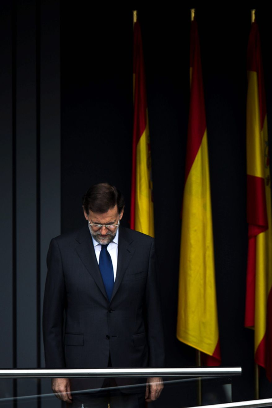 Spain's Prime Minister Mariano Rajoy attends a military parade, during the holiday known as Dia de la Hispanidad, Spain's National Day, in Madrid, Friday, Oct. 12, 2012. Spain is observing its National Day festivities in somber mood as the traditional military pageant was scaled back to cut costs. Spain is in recession and under pressure to fix its finances while celebrating the day Christopher Columbus discovered America in the name of the Spanish Crown. (AP Photo/Daniel Ochoa de Olza)