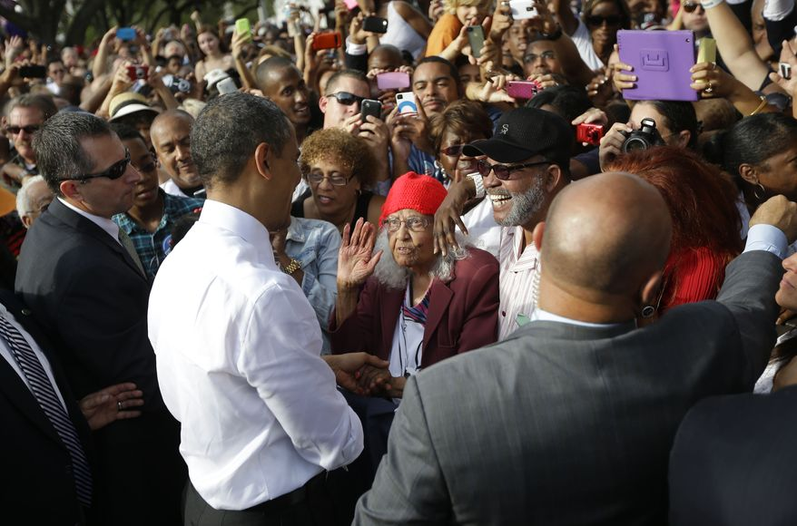 President Obama talks with Carrie Williams (center) and other supporters after speaking Oct. 25, 2012, at a campaign event at Ybor City Museum State Park in Tampa, Fla. (Associated Press)