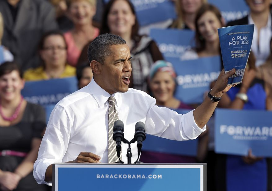 President Obama holds his jobs plans booklet while speaking Oct. 25, 2012, at a campaign event in Tampa, Fla. (Associated Press)