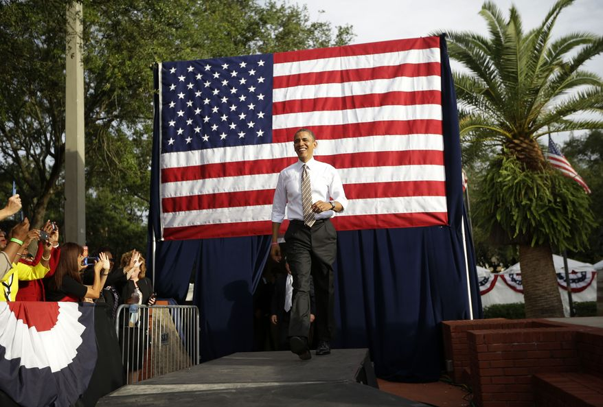 President Obama walks on stage Oct. 25, 2012, as he is introduced at a campaign event at Ybor City Museum State Park in Tampa, Fla. (Associated Press)