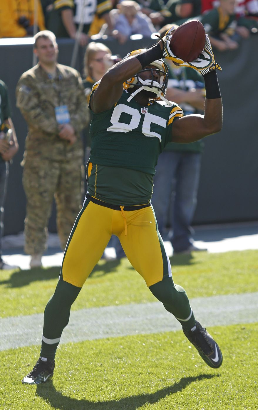 Green Bay Packers wide receiver Greg Jennings catches a ball in warm ups prior to an NFL football game against the New Orleans Saints Sunday, Sept. 30, 2012, in Green Bay, Wis. (AP Photo/Matt Ludtke)