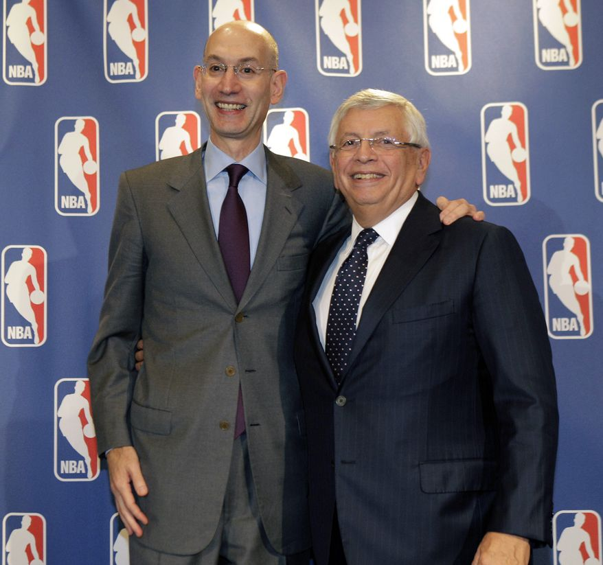 NBA Deputy Commissioner Adam Silver, left, poses for a photograph with Commissioner David Stern during a basketball news conference following Board of Governors meetings in New York, Thursday, Oct. 25, 2012. Stern announced he will retire on Feb. 1, 2014, 30 years after he took charge of the league. He will be replaced by Silver. (AP Photo/Kathy Willens)