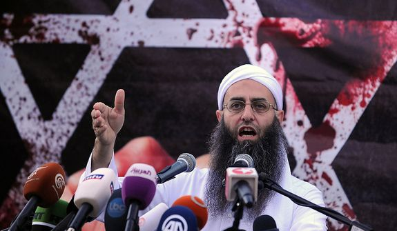 Sunni hardline preacher Sheikh Ahmad Assir speaks during a protest against an anti-Islam movie, in Beirut, Lebanon, Friday, Sept. 21, 2012. Anger over insults to Islam's Prophet Muhammad isn't enough to bring Lebanon's divided Sunni and Shiite Muslims together. The two sects, which have been locked in sometimes violent political competition, held separate protests Friday. Sunni protesters accused Shiite Hezbollah of using the demonstrators to distract from the fighting in neighboring Syria. (AP Photo/Ahmad Omar)