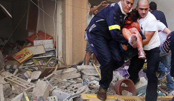 A Lebanese rescue worker, left, and a civilian carry an injured girl from the scene of an explosion in the mostly Christian neighborhood of Achrafiyeh, Beirut, Lebanon, Friday Oct. 19, 2012. Lebanese Red Cross and security officials say a car bomb in east Beirut has killed at least eight people and wounded dozens in the worst blast the city has seen in years, coming at a time when Lebanon has seen a rise in tension and eruptions of clashes stemming from the civil war in neighboring Syria. (AP Photo/Hussein Malla)