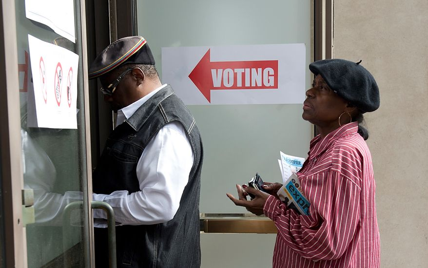 "John and Earline McIntyre wait in line to vote early at Judiciary Square in Washington on Wednesday, Oct. 24, 2012. They said they came early to ""avoid the crowd"" on Election Day. According to site officials, some 2,400 people have voted here since Monday, when the voting opened. The District of Columbia will open seven more early-voting sites on Saturday (one in each ward), which will be open daily except Sundays until Nov. 3 from 8:30 a.m. to 7 p.m. (Barbara L. Salisbury/The Washington Times)"