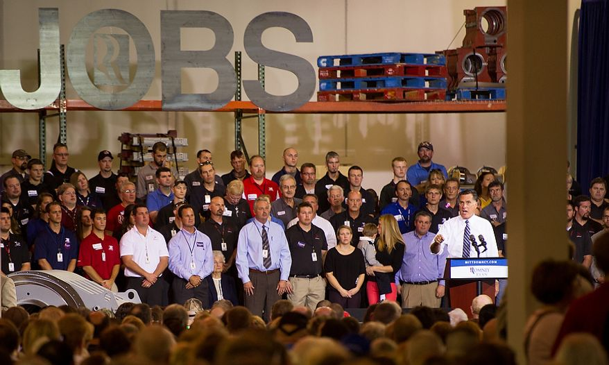 """The word """"Jobs"""" hangs large above the stage where Republican Presidential Candidate Gov. Mitt Romney, right, speaks inside a warehouse at Jet Machine, a small business military manufacturing company, Cincinnati, Ohio, Thursday, October 25, 2012. Since the Iraq war and Afghanistan war draw down, Jet Machine has gone from 160 employees to 115 employees and has begun shifting into manufacturing for oil drilling and hydraulic fracturing. (Andrew Harnik/The Washington Times)"""