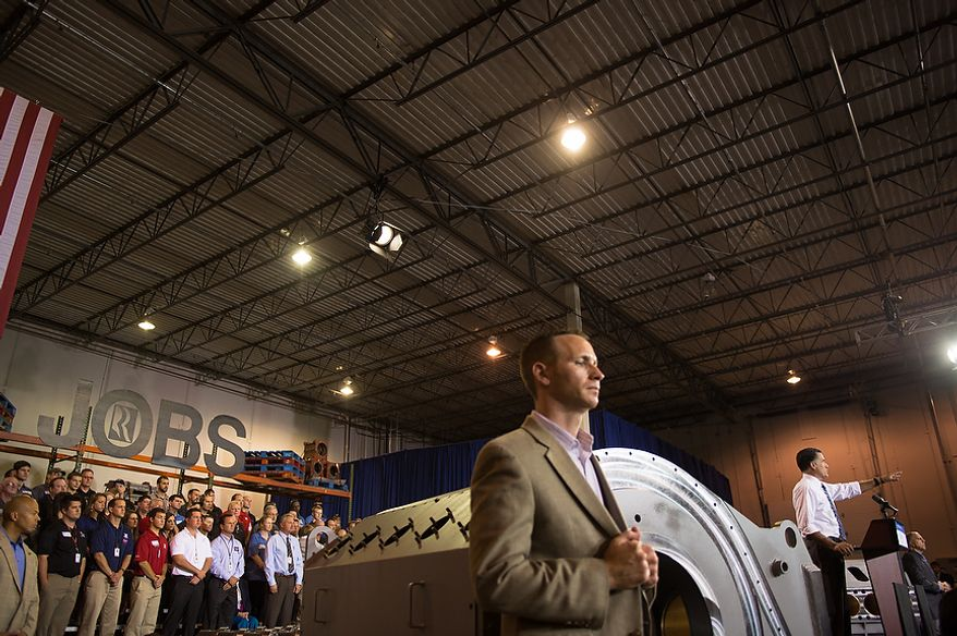 """The word """"Jobs"""" hangs large above the stage, left, where Republican Presidential Candidate Gov. Mitt Romney, right, speaks inside a warehouse at Jet Machine, a small business military manufacturing company, Cincinnati, Ohio, Thursday, October 25, 2012. Since the Iraq war and Afghanistan war draw down, Jet Machine has gone from 160 employees to 115 employees and has begun shifting into manufacturing for oil drilling and hydraulic fracturing. (Andrew Harnik/The Washington Times)"""
