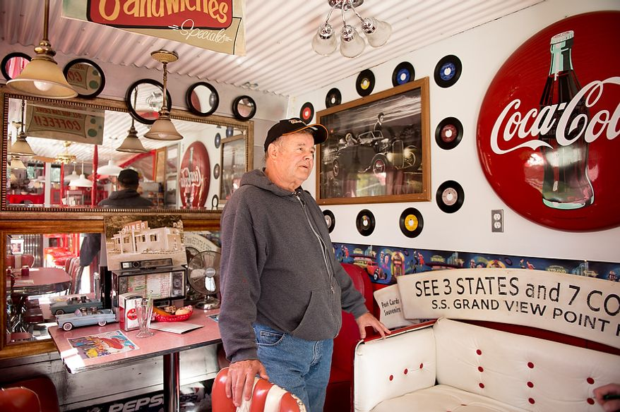 """Dennis Bowser of Alum Bank, Pa., stands inside his small diner replica which he has built on his property, Alum Bank, Pa., Monday, October 22, 2012. """"There's a lot of coal in this area, Says Bowser, """"When you shut coal down, you get rid of a lot of jobs. It's their livelihood."""" (Andrew Harnik/The Washington Times)"""