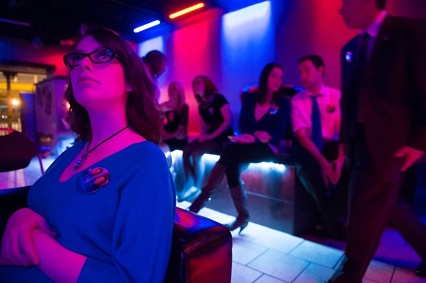 Kelley Dietrich, of Mt. Washington, Pa., left, and other Obama supporters watch the third presidential debate at a debate viewing party at Cruze Bar in downtown Pittsburgh, Pa., Monday, October 22, 2012. (Andrew Harnik/The Washington Times)