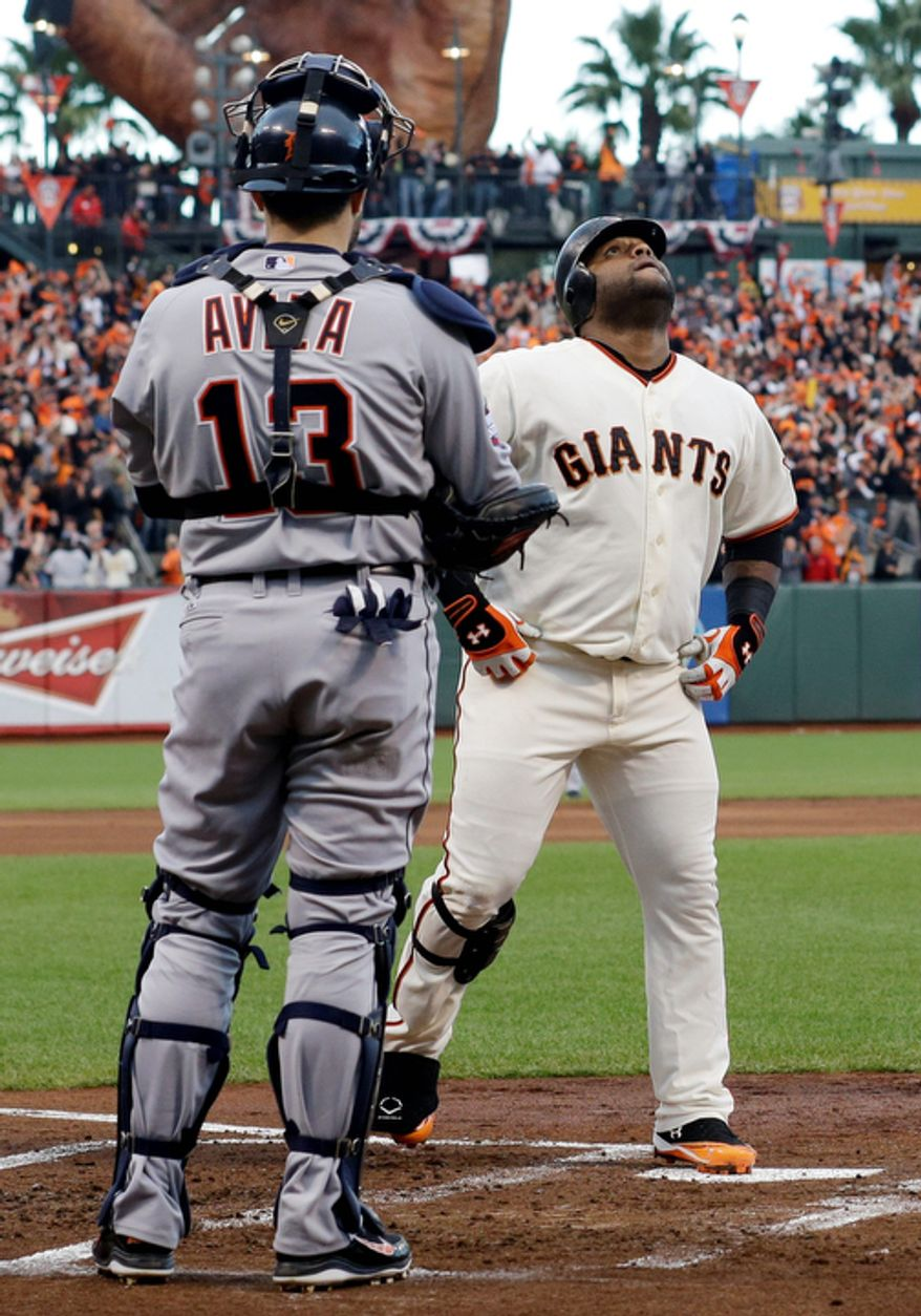 Detroit Tigers catcher Alex Avila watches as San Francisco Giants 3B Pablo Sandoval crosses home after hitting a home run during the first inning of Game 1 of the World Series in San Francisco on Oct. 24, 2012. (Associated Press)