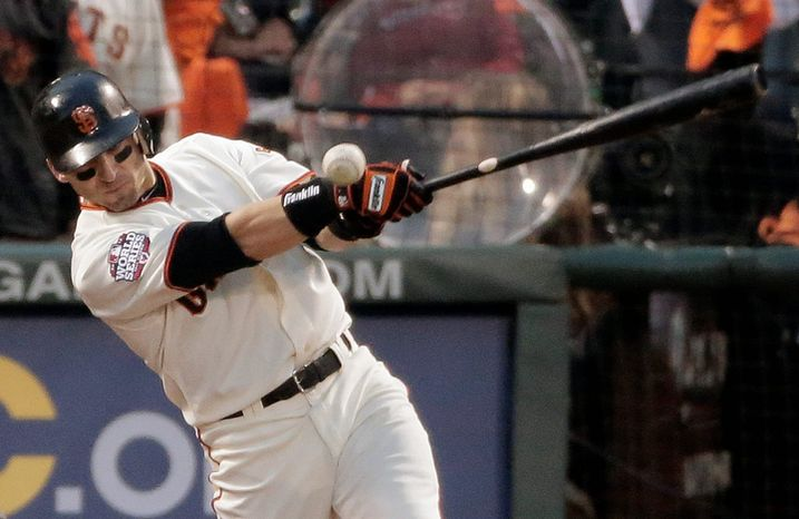 San Francisco Giants 2B Marco Scutaro hits an RBI single off of Detroit Tigers pitcher Justin Verlander during the third inning of Game 1 of the World Series in San Francisco on Oct. 24, 2012. (Associated Press)