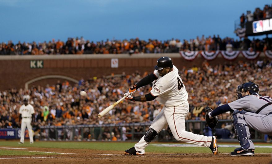 San Francisco Giants 3B Pablo Sandoval hits a two-run home run during the third inning of Game 1 of the World Series between the Giants and Detroit Tigers in San Francisco on Oct. 24, 2012. (Associated Press)