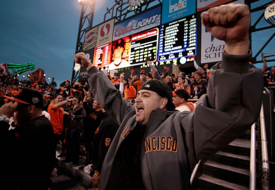 A San Francisco Giants fan reacts after Pablo Sandoval hits a two-run home run during the third inning of Game 1 of the World Series between the Giants and Detroit Tigers in San Francisco on Oct. 24, 2012. (Associated Press)