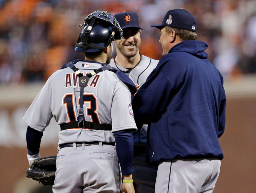 Detroit Tigers pitching coach Jeff Jones (right) talks to catcher Alex Avila (left) and pitcher Justin Verlander during the third inning of Game 1 of the World Series between the Tigers and San Francisco Giants in San Francisco on Oct. 24, 2012. (Associated Press)