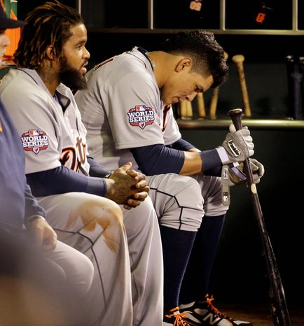 Detroit Tigers RF Avisail Garcia (right) and 1B Prince Fielder sit on the bench during the ninth inning of Game 1 of the World Series between the Tigers and San Francisco Giants in San Francisco on Oct. 24, 2012. (Associated Press)