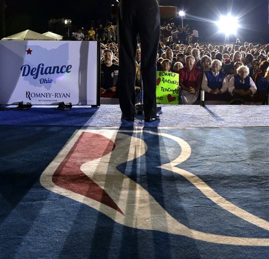 Supporters listen as Republican presidential candidate and former Massachusetts Gov. Mitt Romney campaigns at the football stadium at Defiance High School in Defiance, Ohio, Thursday, Oct. 25, 2012. (AP Photo/Charles Dharapak)