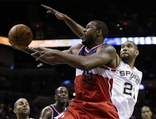 Washington Wizards' Trevor Booker (35) shoots as San Antonio Spurs' Tim Duncan (21) defends during the third quarter of an preseason NBA basketball game, Friday, Oct. 26, 2012, in San Antonio. (AP Photo/Eric Gay)