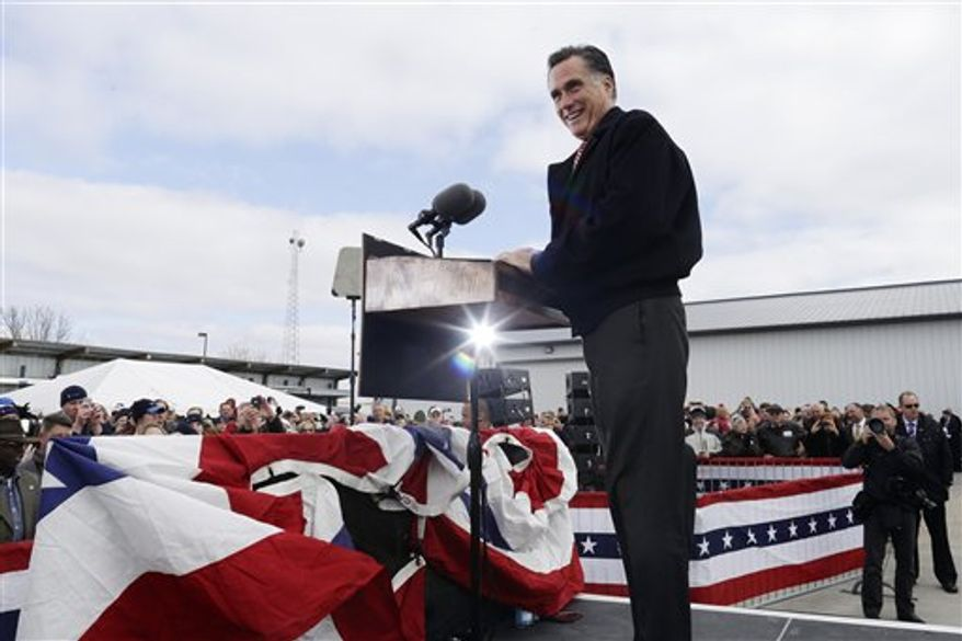 Republican presidential candidate, former Massachusetts Gov. Mitt Romney takes the stage to speak about the economy at a campaign rally at Kinzler Construction Services in Ames, Iowa, Friday, Oct. 26, 2012. (AP Photo/Charles Dharapak)