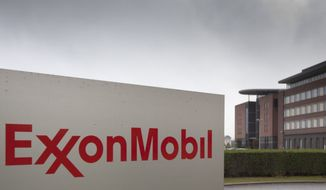 **FILE** The headquarters of ExxonMobil is seen in Brussels on Oct. 26, 2012. (Associated Press)