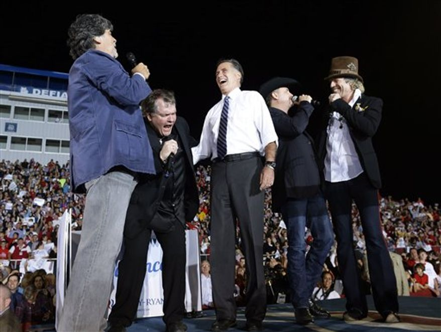 """Republican presidential candidate and former Massachusetts Gov. Mitt Romney, center, sings """"God Bless America"""" during a campaign stop at the football stadium at Defiance High School in Defiance, Ohio, Thursday, Oct. 25, 2012, with, from left, Randy Owen, Meat Loaf, John Rich and Big Kenny. (AP Photo/Charles Dharapak)"""