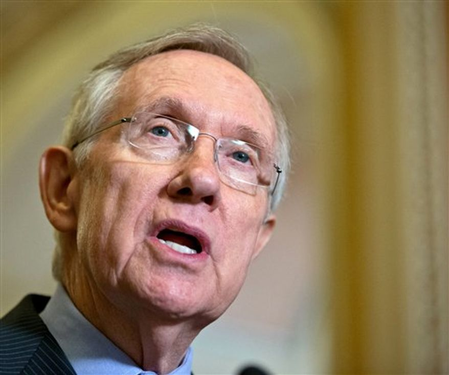 **FILE** Senate Majority Leader Harry Reid, Nevada Democrat, speaks Sept. 19, 2012, with reporters on Capitol Hill in Washington. (Associated Press)