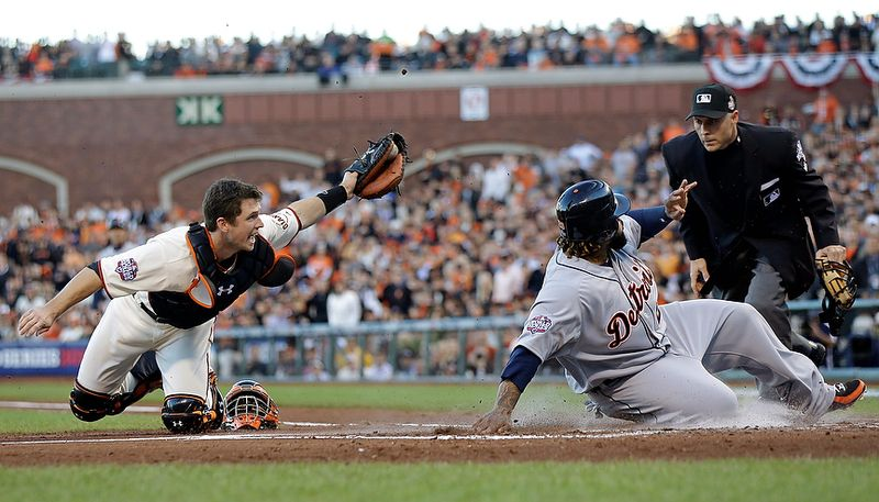 Detroit Tigers 1B Prince Fielder is tagged out at home plate by San Francisco Giants catcher Buster Posey (left) during the second inning of Game 2 of the World Series between the Giants and Detroit Tigers in San Francisco on Oct. 25, 2012. (Associated Press)