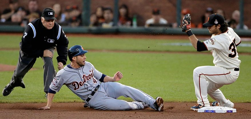 Detroit Tigers 2B Omar Infante is caught stealing second by San Francisco Giants SS Brandon Crawford during the fourth inning of Game 2 of the World Series on Oct. 25, 2012, in San Francisco. (Associated Press)